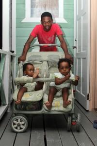 Darius Layne with twins Shaquan (left) and Christiana Greenidge.