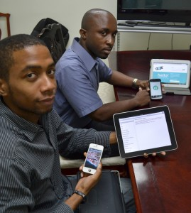 Lybron Sobers (left) of Foo Cafe Barbados and Shannon Clarke of Polyevolution, display some of the gadgets that they can provide the software for.
