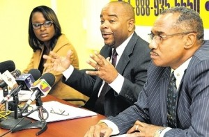Commissioner of the Independent Commission of Investigations Terrence Williams (centre) speaks at yesterday's press conference at the commission's head office in New Kingston. Also pictured are Kahmile Reid, the agency's senior public relations officer, and Lieutenant Colonel Paul Dunn, head of the Special Case Unit.