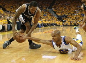 Warriors' Jarrett Jack (right) battles with Spurs Kawhi Leonard for ball possession.