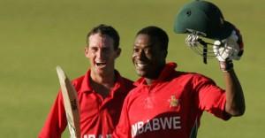 Vusi Sibanda (right) celebrates his century.