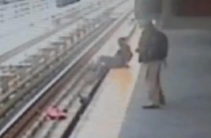 Clip from video showing mother jumping down to rescue baby.