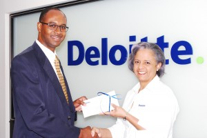 Crime Stoppers' Devrol Dupigny accepts a sponsor's cheque from Betty Brathwaite of Deloitte.