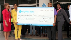 Cranston Browne (second right) and Simone Codrington (right) of the NCF accept the cheque from Deborah Stoute (left) and Sharon Zephirin of Republic Bank.
