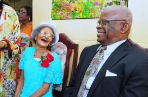 Centenarian Daisy Mahon celebrates with Governor General Sir Elliott Belgrave.