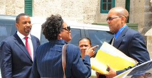 Opposition Leader Mia Mottley (centre) speaking with Kerrie Symmonds (right) while Wilfred Abrahams looks on.