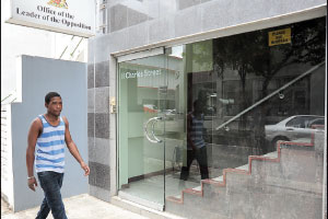A man walks by the entrance to Dr. Keith Rowley's office.