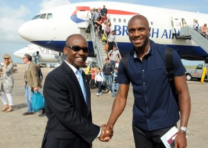Emmerson Boyce (right) was met by Minister of Sport Stephen Lashley on his arrival this evening.
