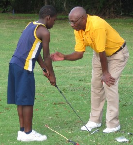 Keith Boyce (right) during one of his training sessions at the Rockley Golf Club clinic.