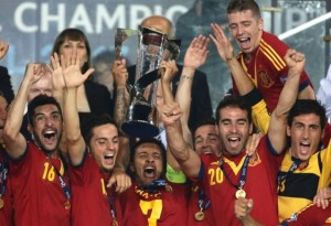 Spain's Thiago Alcántara lifts the trophy after his team beat Italy in the final of the European U21 Championship.