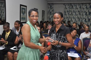Tiffany Shakiera Jordan collects her award.