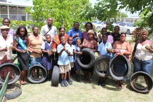 St. Lucy Parish Independence Committee and PTA officials joined with parents for the distribution of tyres and plants at Half-Moon Fort Primary.