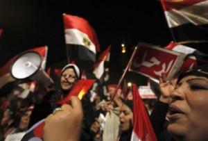 Protesters, opposing Egyptian President Mohamed Mursi, shout slogans during Mursi's speech to the nation in Cairo