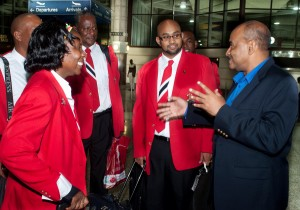 NCF, CEO Cranston Browne greeting Neal Devonish, representative of the Ministry of Arts and Multiculturalism, Trinidad & Tobago and Coordinator for the N.S.S.O tour to Barbados (centre) and a few members of the orchestra at Grantley Adams International Airport last night.