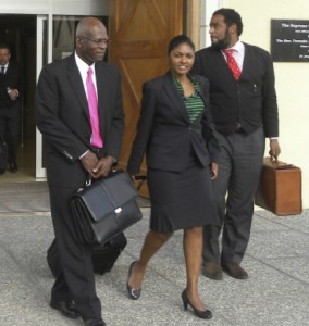 Darwin Dottin (left) leaving court with lawyers this afternoon.