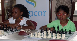 Rachel Pierre-Leandre (left) of Martinique and Barbados' under 10 champ Pritika Kandamaran on the boards.
