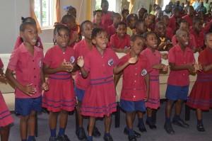 Students jubilant at anniversary church service.