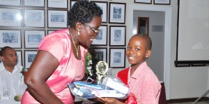Top boy Odean Briscoe receives prizes from Marva Morris.