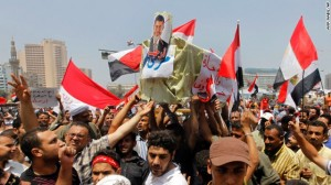 Opponents of Egypt's Islamist President Mohammed Morsi shout slogans as they carry a symbolic coffin of Morsi.