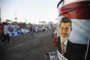 A poster of deposed Egyptian President Mursi is seen as supporters wait to break fast on first day of Ramadan in Cairo