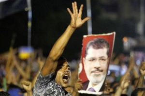 A member of the Muslim Brotherhood and supporter of ousted Egyptian President Mohamed Mursi shouts slogans at the Raba El-Adwyia mosque square in Cairo