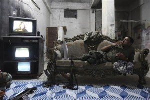 A Syrian rebel in his home.