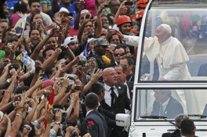 Pope Francis greets crowd of faithful from popemobile in downtown Rio de Janeiro