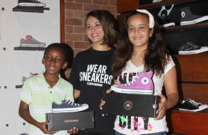 Students Zerayaicob Yaicob and Brianna Williams collect their prizes from Converse store official Sheila Lofgen.