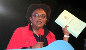 Opposition Leader Mia Mottley with a copy of the Estimates.