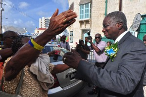 Prime Minister Stuart receives a people's welcome at Parliament.
