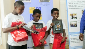 Left to right – Nathaniel Layne, Tre Robinson and Tyrese Robinson showing their Kindle Fire HDs.