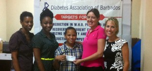 Charity Chicks Barbados Trustees Tracey Worme and Kelly Gibson present their check for $10,000 to Camp Pride of the Diabetes Association of Barbados.