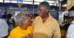 A hug and a smile for Prime Minister and President of the DLP Freundel Stuart.