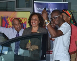 Pic-O-De-Crop Monarch Ian Webster (right) accepts the keys to his Ford Focus from MQI's Margaret Hoyte and Johnny Tudor.