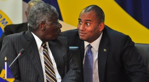 Toursim minister Richard Sealy chatting with PM Stuart.
