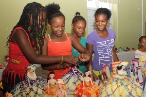 These campers at the Psychiatric Hospital have spent the summer making these beautifully creative dolls, and today they seemed in awe of the final product. Here Damara Bascombe, Kryshara Layne, Shamyh Jacob and Shade Simone enjoy accessorising the dolls.