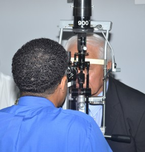 Dr Trevor Drakes of the Lions' Eye Clinic examines the eyes of Samoan Minister of Health, Leao Tuitama.