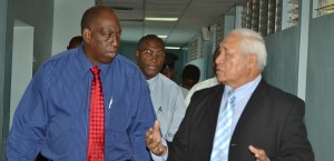 QEH CEO, Dr. Dexter James (left), chatting with Leao Tuitama. In the background is PS Tennyson Springer.