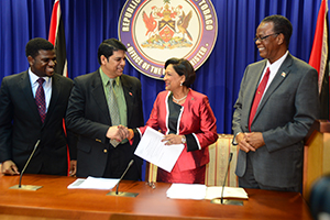 Prime Minister Kamla Persad-Bissessar shakes hands with Legal Affairs Minister Prakash Ramadhar at yesterday's post Cabinet news conference at the Prime Minister's office in St Clair yesterday.