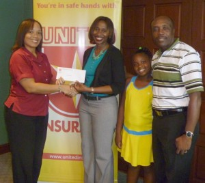 Grace Chambers (second from left) accepts sponsorship from Trudy Bellamy on behalf of daughter Hannah Chambers (second right). At right is dad Alvin Chambers.