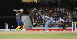 Barbados Tridents' captain Kieron Pollard (left) during his stirring battle against the St. Lucia Zouks' Tino Best last night.