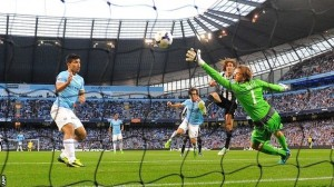 Sergio Aguero (left) watches as this shot flashes past the Magpies' goalie Tim Krul.