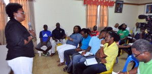Tournament director Mia Mottley (left) talking to some of the football team owners and players.