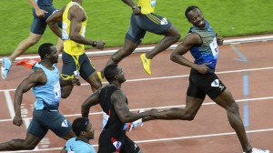 Usain Bolt (right) wins in Zurich today and has time to look back at the opposition.
