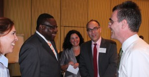 Minister of Social Care Steven Blackett (second left) shares a light moment with UN officials (from left) Lana Blackman; Christine Arab of UN Women; Stephen O'Malley of UNDP, Barbados and OECS, and Richard Blewitt of UNDP, Trinidad and Tobago.
