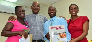 From left: Top overall participant in the Walk the Talk programme Gayle Alleyne, Executive Director Henderson Eastmond, Paul Puckerin, who placed third among the staff, and Administrative Officer Shirleen Inniss share a light moment after the top three achievers were presented with their prizes. Absent is Felix Delice.