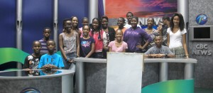 Participants of the camp posing for a photo in the news station at CBC.