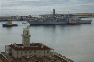 British Royal Navy frigate HMS Westminster is towed towards the port after arriving at Gibraltar bay