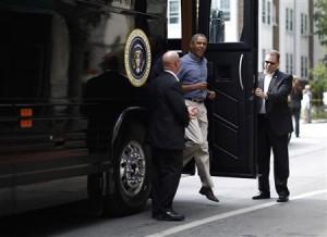 President Barack Obama exits his bus.
