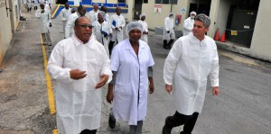 Agriculture Minister, David Estwick (left) on tour of the PHD this morning, accompanied by Acting Managing Director, William Haslett (right) and Quality Assurance Manager, Heather Farrell-Clarke, followed by ministry and dairy officials and media personnel.